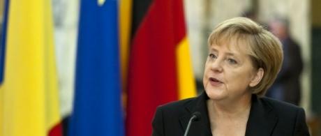 David Cameron and Angela Merkel talk about Europe spotlight image