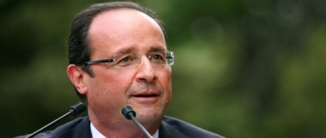 Hollande warns France of tough spending cuts