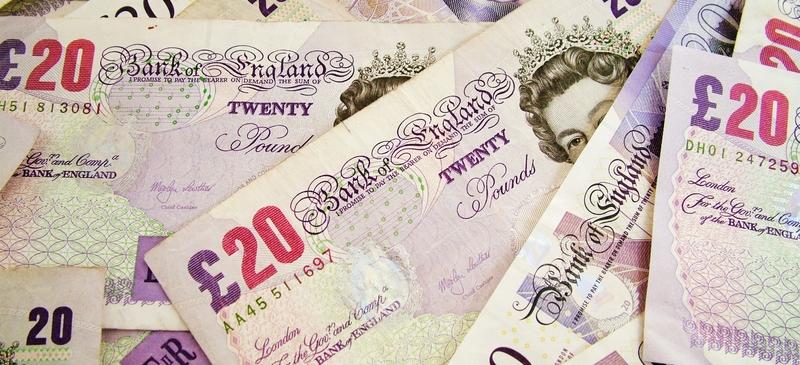 UK government battles to cut deficit