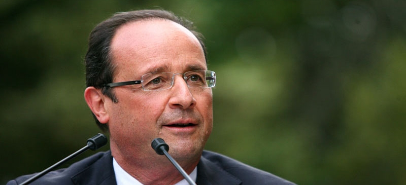 Hollande warns France of tough spending cuts